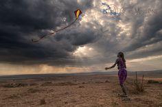 A Maasai Warrior flies a kite for the first time. Ngong Hills, Kenya.
