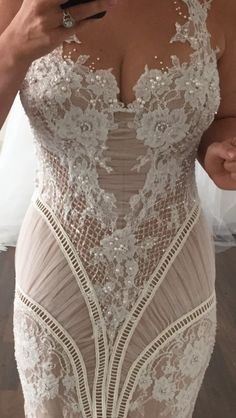 Designer Wedding Dresses that cost nearly nine thousand dollars can easily be replicated for a lot less by our US dress design firm.  We cater to brides on a budget. We have made affordable custom wedding dresses and replicas for brides all over the globe since 1996. We can work from any image you have. www.dariuscordell.com