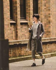 coat, jumper, cuffed trousers, socks and oxfords.