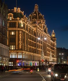 Harrods is an upmarket department store located in London, England. The store occupies a 5-acre (20,000 m2) site and has over one million square feet (90,000 m2) of selling space in over 330 departments making it the biggest department store in Europe. The Harrods motto is Omnia Omnibus Ubique—All Things for All People, Everywhere. Source: Wikipedia | Harrods at Night (London) photo by David Iliff
