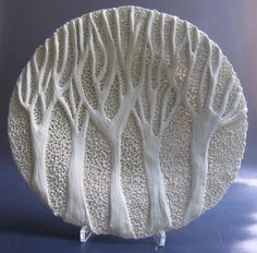 """Rika Herbst Ceramics: """"If my work is to speak I want it to whisper. In this my aim is to create unique pieces for contemplation & enjoyment. Nature is my source of inspiration & delight & it plays a significant role in my work. The shadows cast by the interplay of light are an integral part of each piece & through this I want to give my work a contemporary feel whilst enhancing the quality of the clay. Paper porcelain is versatile & allows me to constantly push the boundaries of my work."""""""