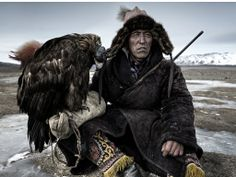 From the shortlist for the 2014 Sony World Photography Awards: eagle hunter Ardak with his golden eagle in the Altai region of western Mongolia Photographer: Simon Morri