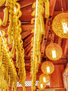 Walking around Hanok Villag in South Korea, checking out ceilings. Repin if you love colorful hanging food!