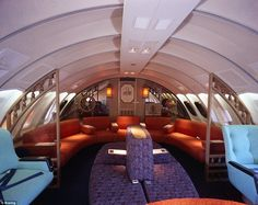Inside a Qantas Boeing 747, the nautical theme is blended in with the clashing colours of ...