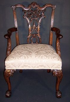 """Ribbon Back"" dining armchair by Thomas Chippendale, 1755.  This chair is an example of the extent to which a carver could go to embellish his furniture."