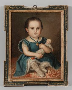 portrait of a young girl in a lacy blue dress holding a doll