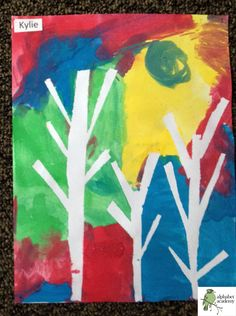 Colorful tape-tree art! We used blue painters tape to outline different style trees on card stock. The children used tempera cakes to paint the entire paper. We then removed the tape to reveal unique tree landscapes.