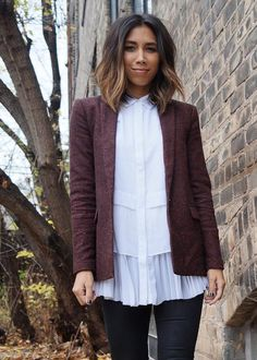 Gabriella Moreno keeps her street style polished in this white multi-layer button down shirt with ruffle hem and a structured burgundy blazer | Banana Republic