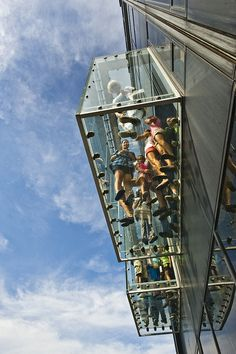 Chicago...  The Ledge's glass boxes extend out 4.3 feet from the Willis Tower on the 103rd floor. Each box weights 7,500 lbs.
