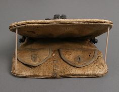 Date: 15th–16th century Culture: European Medium: Iron, leather Dimensions: Overall: 9 x 7 1/16 x 1 5/8 in. (22.9 x 17.9 x 4.1 cm) purse clasp only: 5 x 6 x 1 5/8 in. (12.7 x 15.2 x 4.1 cm) Classification: Metalwork-Iron