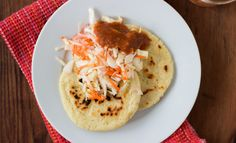 Authentic El Salvadoran pupusas are thick corn cakes filled with cheese and other fillings. Here, we show you how to make them step-by-step.