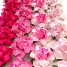 Wedding DIY Ideas - decorate most anything with pretty paper flowers, available in 22 custom colors!  DIY centerpieces, DIY invitations, or DIY Place Cards.  Shown here in ombre pink shades of Magenta, Fucshia & Blush Pink - http://www.karasvineyardweddingshop.com/collections/diy-supplies/products/handmade-paper-flowers-for-wedding-diy-projects-crafts
