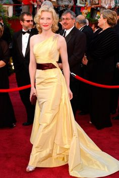 CATE BLANCHETT  Cate Blanchett wowed in this buttercup yellow and burgundy couture gown by Valentino to walk the red carpet at the 2005 Academy Awards. (2005)
