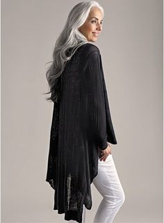 Beautiful cardigan and I love her gray hair. If mine were that color I would never color my hair again!
