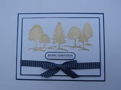 hand crafted card: Lovely as a Tree by rainyboxcrafts  ... gold embossed tress ... navy mats, ribbon and ink ... lovely card ... v