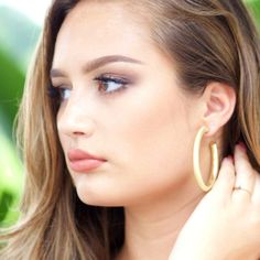 Medium Gold Hoop Earrings from Cousin Couture.