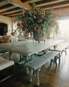 This is my dream dining room table. Concrete Faux Bois. It weighs a million tons though and probably costs a million too.