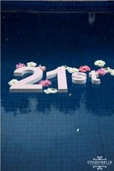 I love the idea of floating Styrofoam letters in the pool.  I imagine they are tied together with invisible line.