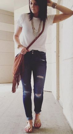 Fashion made easy in destructed denim and a solid white tee.