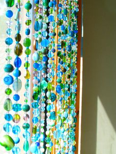 Bided curtain gorgeous spiritual hanging suncatcher-it is made of glass beads in different shapes and sizes. Indoor Outdoor Decor Curtain