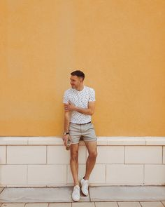 Stylish Men's Summer Fashion Outfit think sand shorts, paired with a simple white pattern t shirt.