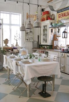 vintage kitchen Vintage cabinets and industrial lighting and signage combines country styles in this kitchen Farmhouse Kitchen Decor, Vintage Farmhouse, Vintage Kitchen, Kitchen Dining, Farmhouse Style, Eclectic Kitchen, Kitchen Interior, Diner Kitchen, Swedish Kitchen