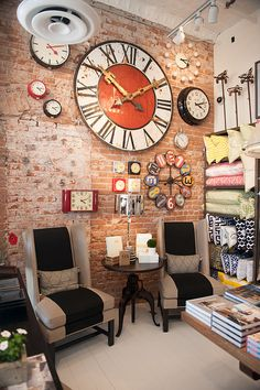 Our store is open - love the clock wall! design*lab by ddg