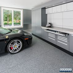 The modern design of the GL NEOS Elite hides all visual clutter. A custom wall p. - Garage Designs - The modern design of the GL NEOS Elite hides all visual clutter. A custom wall panel behind the - Garage Floor Coatings, Garage Floor Epoxy, Garage Walls, Garage Cabinets, Garage Doors, Car Garage, Garage Flooring, Small Garage, Home Garage