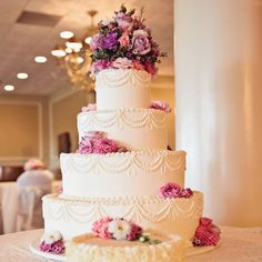 Traditional four tier wedding cake with fresh flowers // Tavistock Country Club // http://www.theknot.com/weddings/album/148857