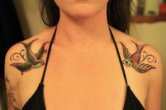 swallow: sailors would get after traveling a certain number of miles, (5000?) also sometimes seen as good luck for the journey home.  Seems kind of fitting for a mid-life tattoo.