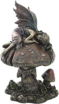 This statue features a pretty fairy is seen sleeping on a mushroom. This lovely fairy statue was made with great attention to detail.