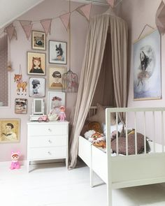 Love this pastel pink girl room Numero74 featured products: canopy, heart & star cushions, bunting garland, bohemian bird cage..