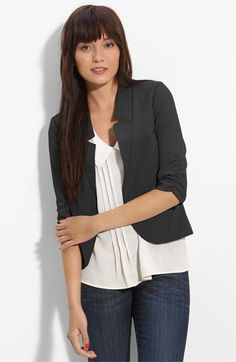 A flowy top keeps you comfortable while a blazer helps to compliment your figure
