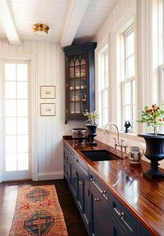 Beautiful cabinets and butcher block countertops.