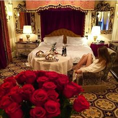 red roses food service trays bed ornate mirror elegant rug lamps curtains drapes legs white robe girl hair dressers linen elaborate chair wine