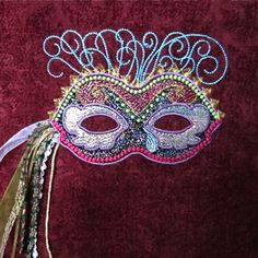 Mardi Gras Mask 5x7  A stunning embroidery and applique design! Create gorgeous wearable art or home decor accents.  Full photo and step by step instructions are included to make creating this richly embellished mask fun, fabulous and easy to do. Each creation truly becomes a one of a kind exclusive!  $7.00