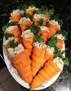 Chicken salad, crescent rolls w egg was and orange food color- baked on horn rolls- kale for the greens