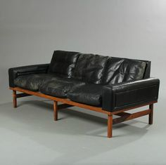 // Henry W. Klein; Rosewood and Leather Sofa for Bramin, 1960s.
