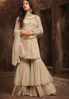 Buy Sonal Chauhan Dusty Net tops with santoon inner and bottom and chiffon Dupatta.in UK, USA and Ca