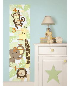 Create a fabulous feature in moments with this adorable Jungle Growth Chart from Wallpops. The self-adhesive height chart is a easy and affordable way to track your child's growth with minimal fuss or effort. The chart has cute jungle animals all over it and would look great in a nursery, playroom or bedroom.