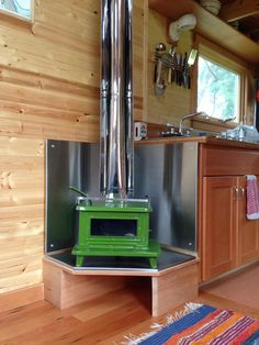 Gorgeous! Marine heating/cookstove that she chose. It can be spray painted with stove paint or have enamel baked on by the company. I will install copper surround and place up high for cooking and safety's sake. jenn-tiny-house-4