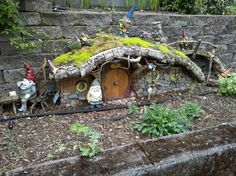 This is the proper way to do garden gnomes...givem' a nice house and incorporate some moss!