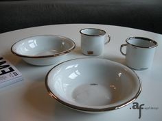Agaf Design Gold and Platinum hand painted porcelain pieces on the coffee table