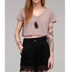 Free People Crop Top Free People boxy v neck crop top. Size medium. So cute with so many outfits. One tiny stain but it's not noticeable (shown in 4th pic). This specific top has been sold out everywhere for a while now.   I have a 30% bundle discount and I accept all reasonable offers so don't be shy!! Free People Tops Crop Tops