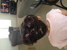 Little girl hairstyle. Lobe the braid from the bottom