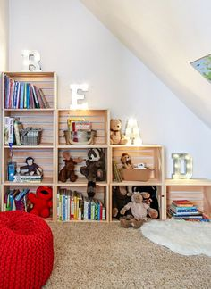 Stackable crates, either bought ready made or make your own, allow you to stack up a storage unit that can be used for books and small toys. Arrange the crates so as to be within easy reach for your toddler, and put down a rug or pouf to make it a comfortable place to sit and read.