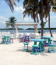 Colorful Caribbean seating and a view of the bay at Morada Bay Cafe/Pierre's Restaurant, Islamorada