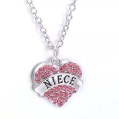 "Niece Necklace Cute silver toned zinc alloy necklace. This has pink rhinestones. New in package. Chain is about 24"" plus 2"" extender. Your niece will love it and feel loved when she receives it!  Jewelry Necklaces"