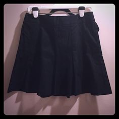 Banana republic skirt, dark navy Skirt fits and flares. A few inches above the knee. Zipper back. Cotten/spandex Banana Republic Skirts