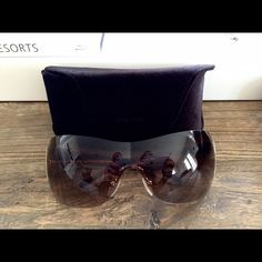 Prada spr54g authentic sunglasses In great condition! This comes with the case but it is Tom Ford because I don't have the original Prada case. Prada Accessories